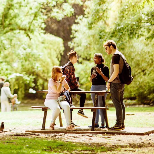 Press or Publication-Students around Picnic Bench in Pearson Park 1900x800
